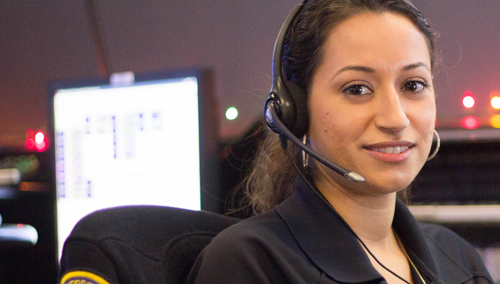 Dispatcher with headset in Communications Room