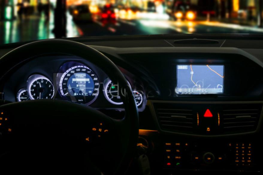 vehicle dashboard at night