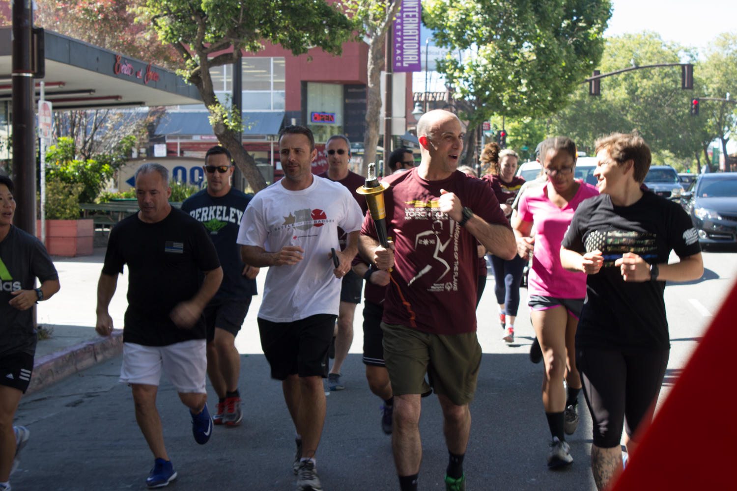 Runners from BPD and UCPD on Shattuck